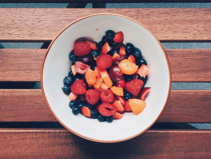 Directly above view of fresh fruit salad in bowl on table