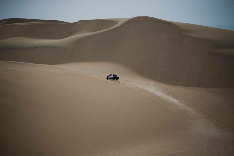Arid Climate Beauty In Nature Car Climate Day Desert Environment Land Land Vehicle Landscape Mode Of Transportation Motor Vehicle Nature No People Non-urban Scene Off-road Vehicle Outdoors Road Trip Sand Sand Dune Scenics - Nature Sports Utility Vehicle Transportation Travel