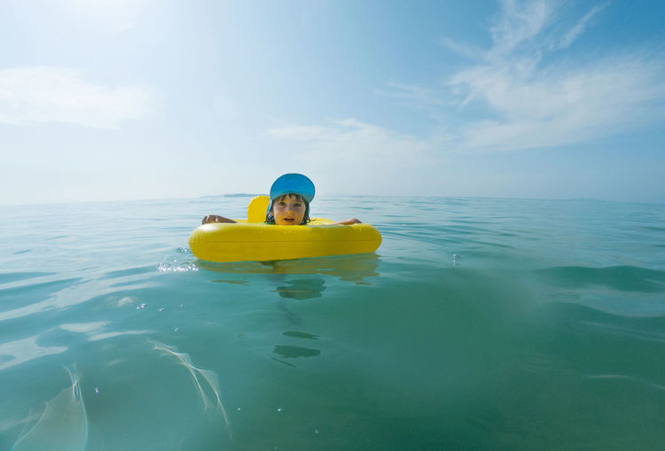 Adorable baby girl swimming in the sea in a rubber ring Water Sea Sky Day Yellow Nature Leisure Activity Outdoors Rubber Ring Kid Child Childhood Toddler  Toddler Girl Summer Vacation Cute Baby Beach Swimming Kids Being Kids Summer Tropical Paradise Having Fun With Kids Quality Time Baby Girl Sunshine