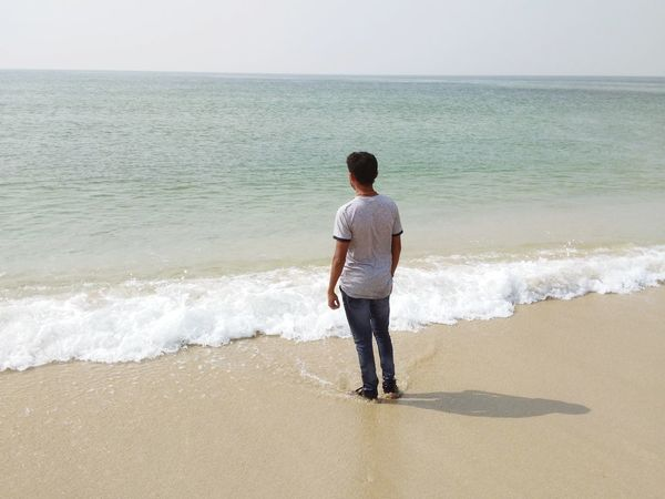 Beach Sea Sand Rear View Horizon Over Water One Man Only One Person Only Men Vacations Full Length Wave Standing People Adults Only Tranquility Water Sunlight Day Adult Outdoors