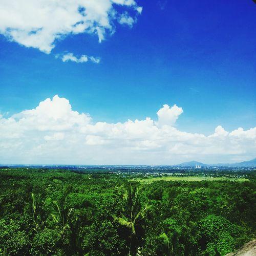 Blue sky, green hill
