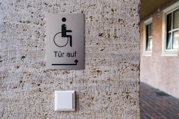 Disabled Sign On Concrete Wall