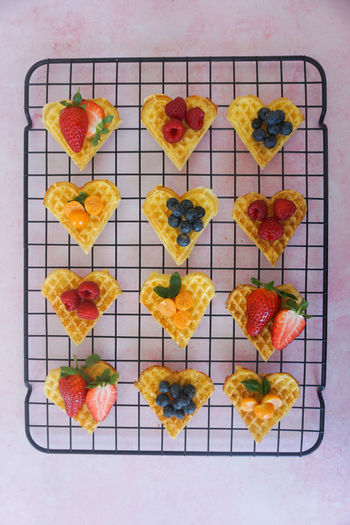 directly above of waffle hearts with berries Physalis Berry Fruit Berry Berries Blueberry Blueberries Strawberry Waffle Waffle Time Waffles!! Vaffel Sweet Food Food National Waffle Day Waffel Snack Studio Shot Variation Fruit Directly Above Italian Food Arts Culture And Entertainment High Angle View Cheese Food And Drink Strawberry Berry Fruit Blueberry Tart - Dessert Raspberry