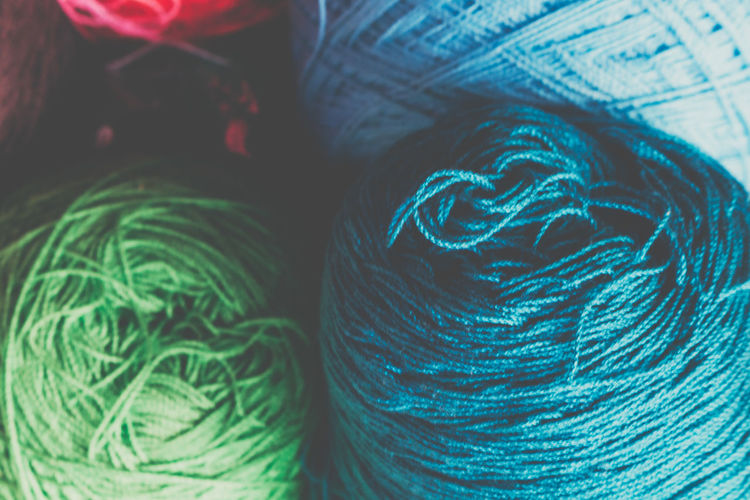 Thread Silk Colors Art And Craft Backgrounds Ball Of Wool Blue Close-up Creativity Day Focus On Foreground Full Frame Green Color Indoors  Material Multi Colored No People Pattern Selective Focus Silk Softness Still Life Textile Thread Vibrant Color