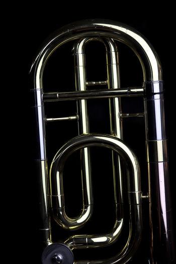 Music Instrument Trombone Metal Studio Shot Brass Instrument  No People Black Background Indoors  Musical Instrument Brass Music Arts Culture And Entertainment Shiny Wind Instrument Close-up Arch Night Dark Illuminated Window Cut Out Trumpet