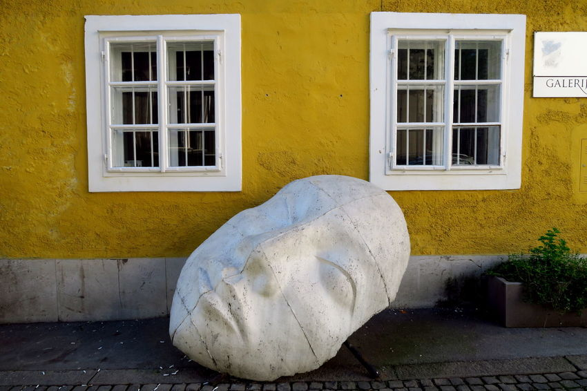 Windows on the Colours of Ljubljana Architecture Arts And Crafts Building Building Exterior Built Structure Day Gallery Gallery Of Art Mask Masks Masks Arts And Crafts Masque No People Outdoors Residential Building Stone Head Yellow Yellow House