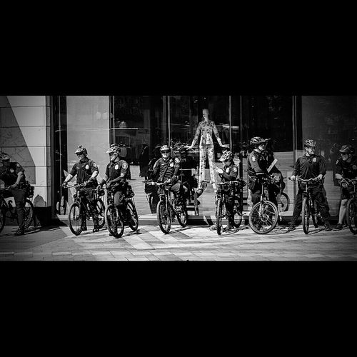Who's really in charge here? Police Angel Guardian Angel Safety Cops Bike Cops Seattle Crowd Control Crowdcontrol Blackandwhite Black And White Streetphotography Street
