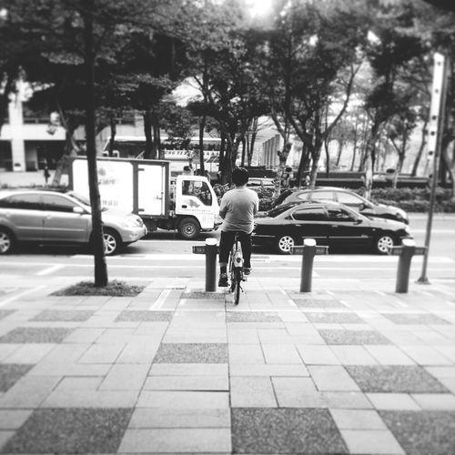 Sits on the ubike Monochrome Streetphotography People Ubike