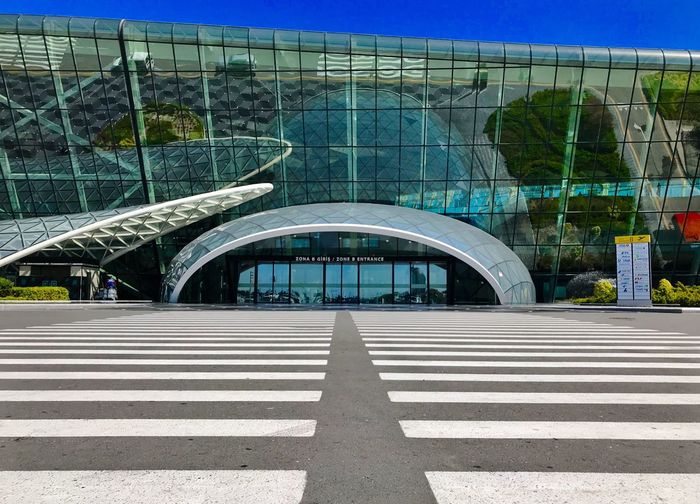 Amazing architecture in beautiful Baku city Airport Travel Airport Azerbaijan Baku IPhoneography Architecture Built Structure Transportation Connection Bridge Road Marking Symbol Day Sunlight Crosswalk Road City