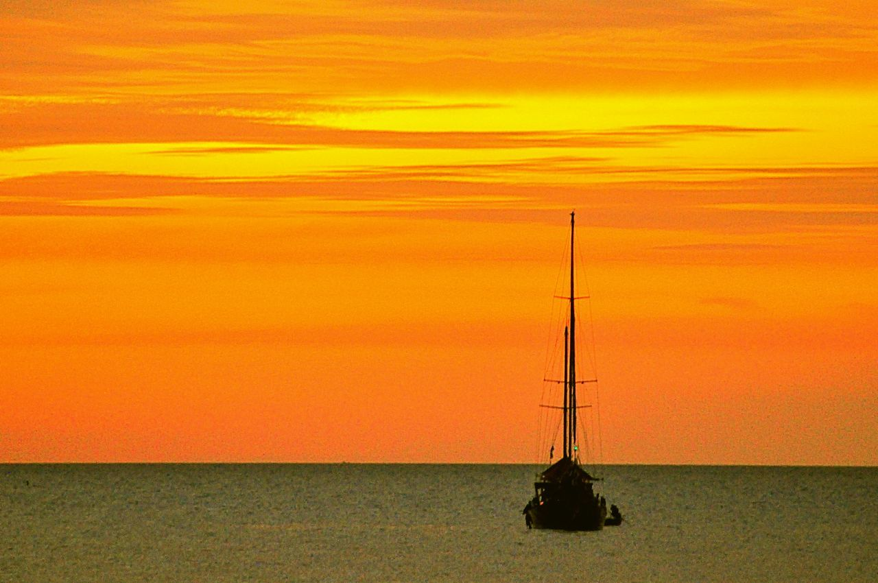 sunset, sea, water, horizon over water, orange color, scenics, nature, beauty in nature, tranquil scene, sky, no people, tranquility, outdoors, nautical vessel, fishing pole, day