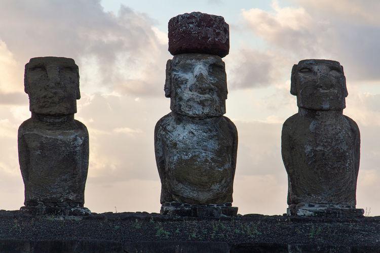 Statue of historic building moai against sky