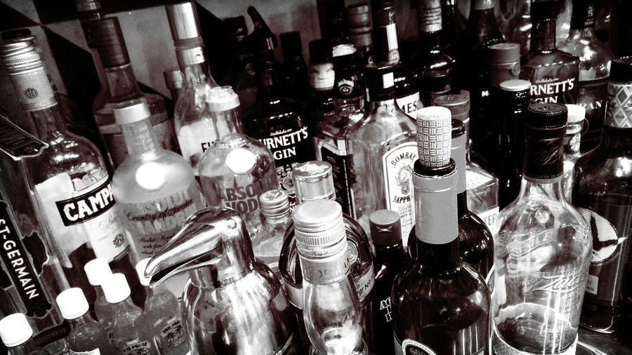 Alcohol Alcohol Bottles Alcoholic Drink Bar - Drink Establishment Bar Counter Bar Scene Bar Time  Black And White Bottles Bottles Collection Campari Drinks For Sale GIN Illuminated Large Group Of Objects Lomography Night Retail  Rum Vodka Whiskey Whisky Zacapa