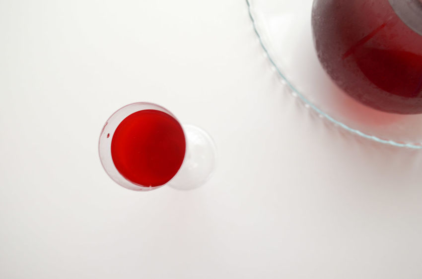 A Bird's Eye View Beverage Close-up Cup Directly Above Drink Drinking Freshness From Above  Glass Juice Light And Shadow No People Onthetable Overhead View Part Of Red Red Color Refreshment Still Life White White Album White Background White Color WhiteCollection