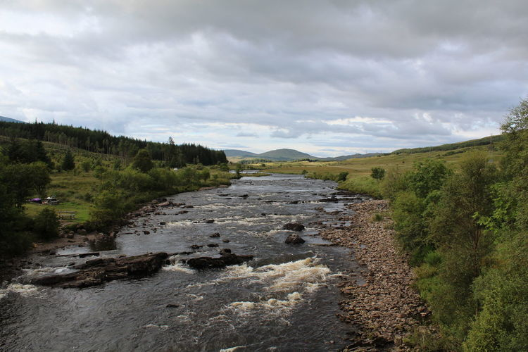 Scotland Beauty In Nature Bridge Of Orchy Bridge View Cloud - Sky Day Environment Flowing Green Color Growth Land Landscape Nature No People Non-urban Scene Outdoors Plant River Scenics - Nature Scottish Highlands Sky Tranquil Scene Tranquility Tree Water