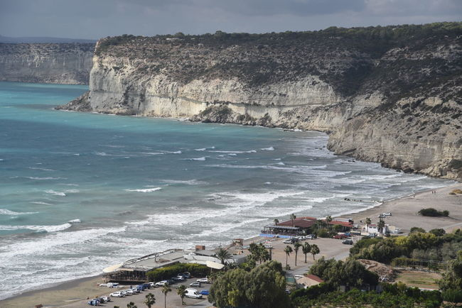 Cyprus Felsen Am Strand Meer Palmen Strand Architecture Beach Beauty In Nature Building Exterior Built Structure Cliff Day Horizon Over Water Mountain Nature No People Outdoors Scenics Sea Sky Tree Water Wave Zypern