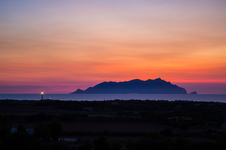 Sunset Landscape Mountain Nature Outdoors Beauty In Nature Cloud - Sky Travel Destinations No People Scenics Night Summer Nature Sky Sunlight Day Sea Life Sicily Photooftheday Beauty In Nature Canon100D Canon_photos Sea Water Favignana's Sea