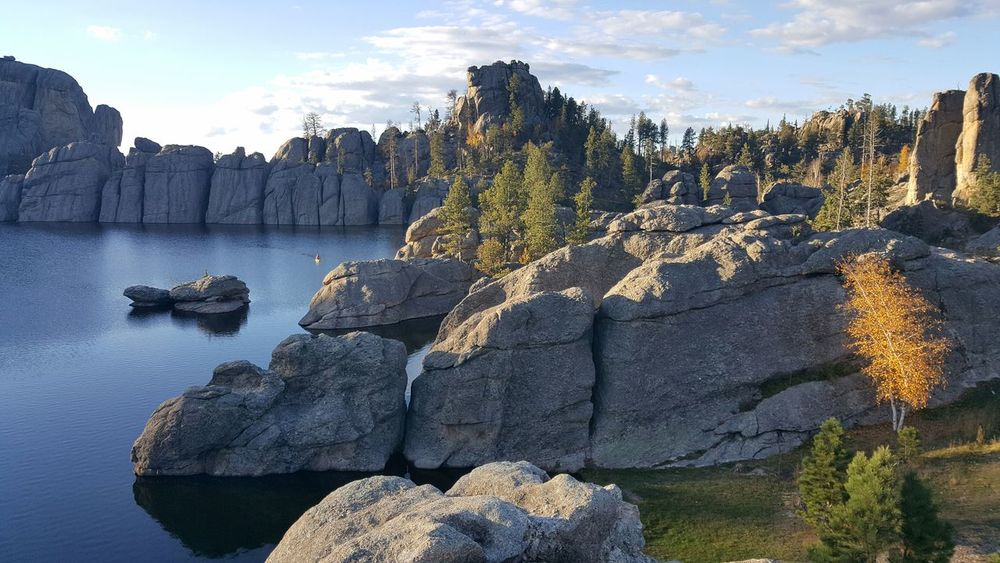 TakeoverContrast Tranquility Scenics Nature Water Rocks Rocks And Water Sylvan Lake Outdoors Beauty In Nature Rock Formation Fall Colors Earthporn No People Cloud - Sky