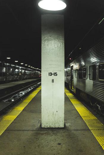 Illuminated subway station platform at night