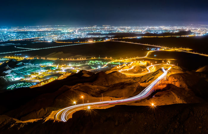 the curly road Abu Dhabi Al Ain Hafeet UAE Aerial View Beauty In Nature City Cityscape High Angle View Illuminated Jebe Jebelhafeet Landscape Light Trail Mountain Nature Night No People Outdoors Road Scenics Sky Transportation Water