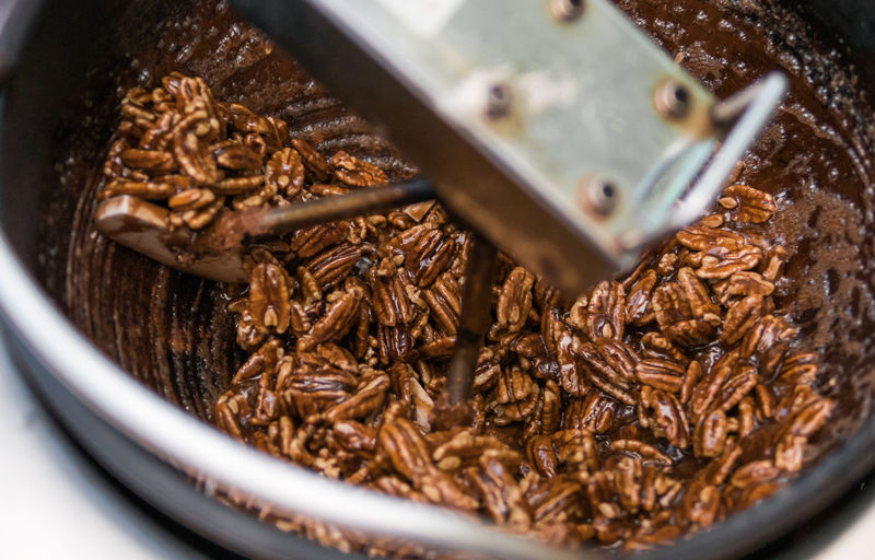 Close up of pecans being roasted in a machine. Food Food And Drink Brown Indoors  No People Close-up Sweet Food Dessert Healthy Eating Container Sweet Selective Focus Freshness Healthy Lifestyle