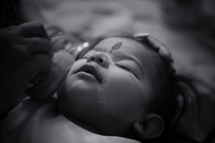 Little baby girl is being cared of by her mother. Baby Care Childhood Close-up Cute Depth Of Field Indian Indoors  Innocence Mother Care Portrait Powderpuff Relaxation Selective Focus