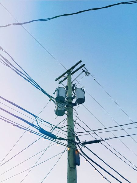 The modern cross. Electricity Pylon Blue Blue Sky Canada