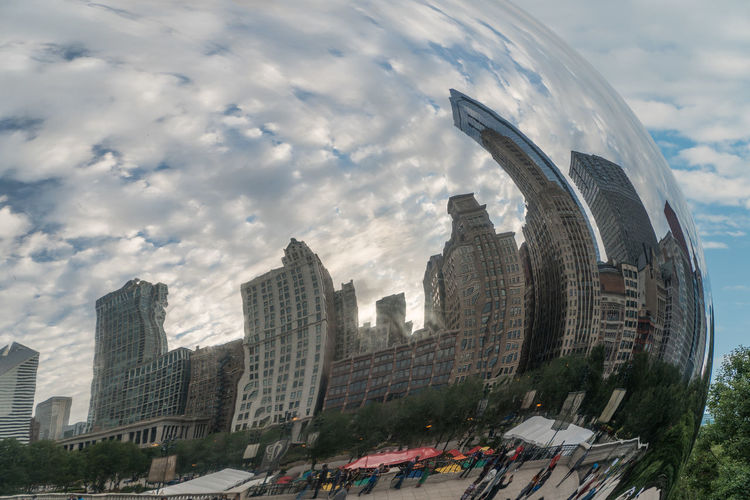 Digital composite image of modern buildings against sky