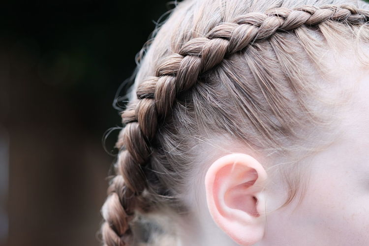 Cropped image of girl with braided hair