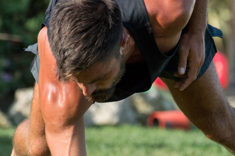 Close-up of man exercising in lawn