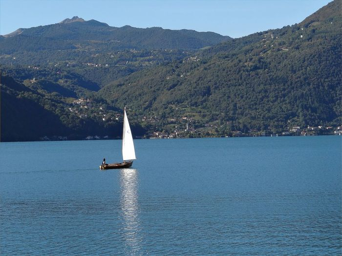 Beauty In Nature Clear Sky Day Lake Mountain Nature Nautical Vessel No People Outdoors Sailboat Sailing Scenics Sky Tranquil Scene Tranquility Transportation Water Waterfront