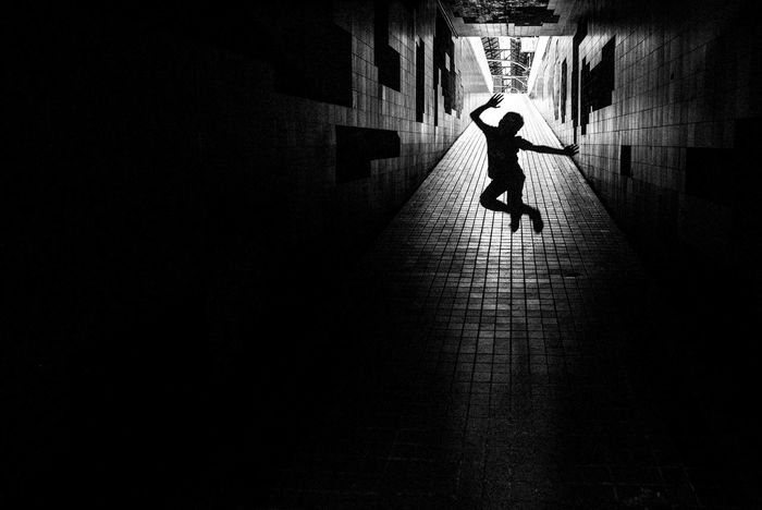 Architecture Black And White Friday Boy Jumping Energetic Fun Photography Indoors  Light At The End Of The Tunnel Railway Station Shadow Silhouette Tunnel See The Light