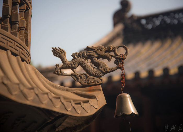 Close-up of bell hanging on roof