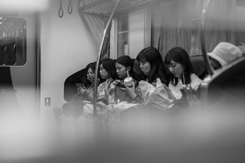 Group Of People Women Indoors  Sitting Adult Reflection People Lifestyles Real People Young Women Young Adult Arts Culture And Entertainment Leisure Activity Music Waist Up Casual Clothing Illuminated Togetherness Friendship Lighting Equipment