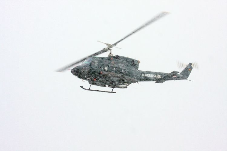 Bell UH-1D Air Vehicle Copy Space Day Flying Helicopter Mid-air Mode Of Transportation No People Search And Rescue Snow Storm Transportation White Background
