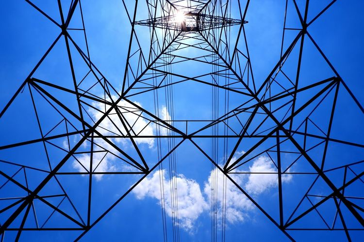 Ant eyes view of high voltage tower structure with power lines against white cloud and blue clear sky background in sunny day Technology Ant Eyes View Low Angle View Geometric Silhouette Structure Metal High Voltage Tower Cloud - Sky Clear Sky Sunny Day Sun Flare Girder Concentric Electricity Pylon Symmetry Steel Electricity  Cable Above Pattern Below Under Electrical Grid Power Line  Power Cable Power Supply Construction Frame Wire