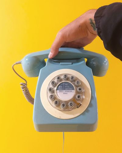 Hold Yellow Human Hand Human Body Part Hand Retro Styled Telephone Technology Studio Shot Form Of Communication Close-up Communication Holding Landline Phone Connection One Person Rotary Phone Nostalgia Telephone Receiver Indoors  Finger