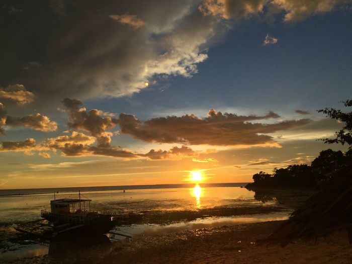 Sunsets and memories Iphonography Wonders Travel Philippines No People Outdoors Day Reflection Sunlight Beach Tranquil Scene Tranquility Nature Horizon Over Water Cloud - Sky Silhouette Beauty In Nature EyeEmNewHere Water Sun Sky Scenics Sea Sunset