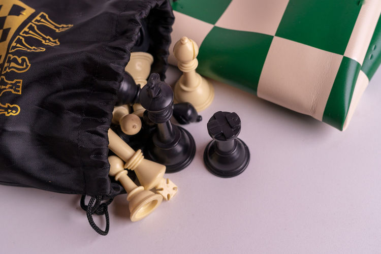 Chess set on white background. Indoors  Chess Game Competition Queen King - Royal Person King Army Strategy Leader Leadership Decisions Board Game Chess Piece Leisure Games Black Color Leisure Activity Relaxation High Angle View Arts Culture And Entertainment White Color Still Life People Chess Board Close-up Government Challenge King - Chess Piece Aggression