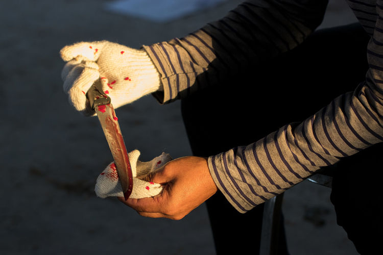 Murder Close-up Day Focus On Foreground Food Hand Holding Human Body Part Human Hand Lifestyles Nature Occupation One Person Outdoors Protection Real People Scared Wood - Material Work Tool Working