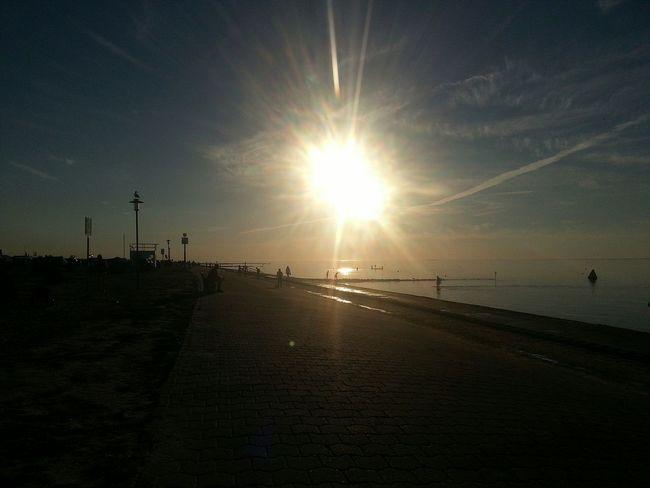 Sun Sunset Sunlight Tranquility Sky Nature Sea Beach Outdoors Beauty In Nature Scenics Horizon Over Water Water Silhouette Neuharlingersiel Live For The Story The Great Outdoors - 2017 EyeEm Awards Summer Exploratorium