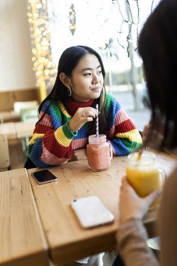 Portrait of a woman drinking drink