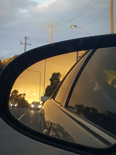 two different views on a same time Melbourne City MelbournePhotographer Melbourne Travel Destinations Scenic View EyeEm Gallery EyeEm Best Shots EyeEm Selects Enjoyeverymoment Enjoying Life Evening Sunset Sunset_collection City Drive Sunsetonroad Road Car Carmirror Carmirrorshot Carmirrorimages Carmirrorsunset Business Finance And Industry No People Day Close-up City Spiral Staircase Architecture Sky