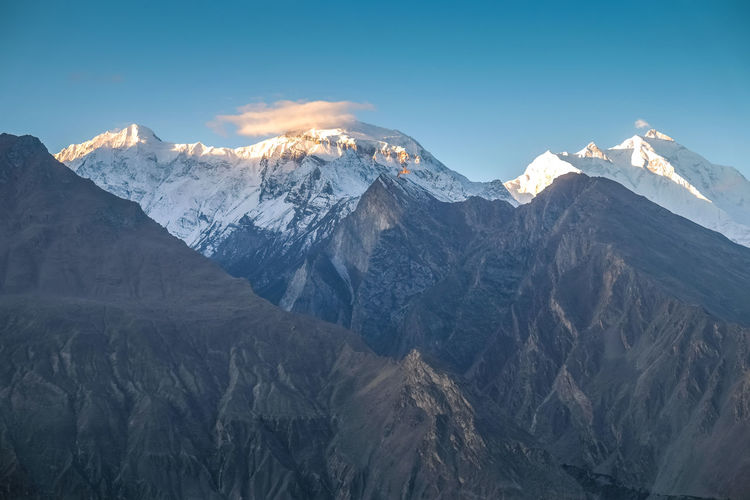Sunrise at Nagar valley with a view of snow capped Rakaposhi mountain in Karakoram range. Gilgit baltistan, Pakistan. Pakistan Gilgit Baltistan Hunza Valley Environment Ecology Nature Landscape Snow Cold Temperature Mountains Karakoram Mountain Range Mountain Peak Mountainscape Snow Capped Mountains Green Blue Travel Destinations Eco Tourism White Scenic Beautiful Scenery Outdoors Geology Landmark Rural Wilderness Area Into The Wild Trekking Hiking Adventure Ridge Natural Beauty Freshness Clean Air Fresh Air Pure Air Pollution Free Countryside Journey Autumn Hills Scenics ASIA Vacations Trip View High Altitude Backpacking Solotraveler Peaceful Peace And Quiet Mountainous Rakaposhi Nagar Valley Tranquility Non-urban Scene Tranquil Scene No People Sunrise Sunset