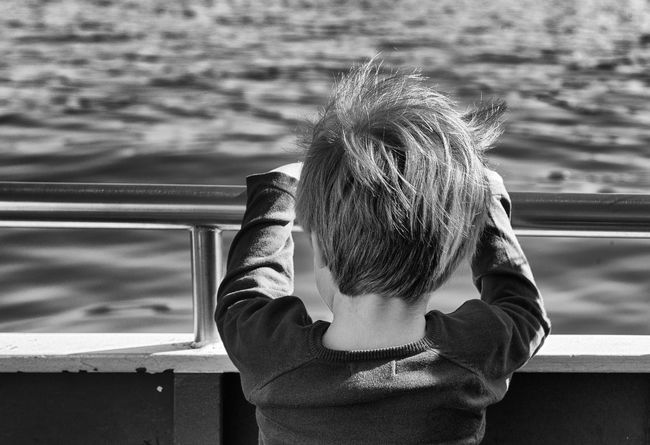 Ferry Tale Blackandwhite Lake Wind Little Boy On Boat Autumn Mood Portrait From Behind Summicron 35mm EyeEmNewHere This Is Natural Beauty Leica M9 Ferry Boat Water Child Childhood Outdoors Headshot Holiday Moments A New Perspective On Life It's About The Journey