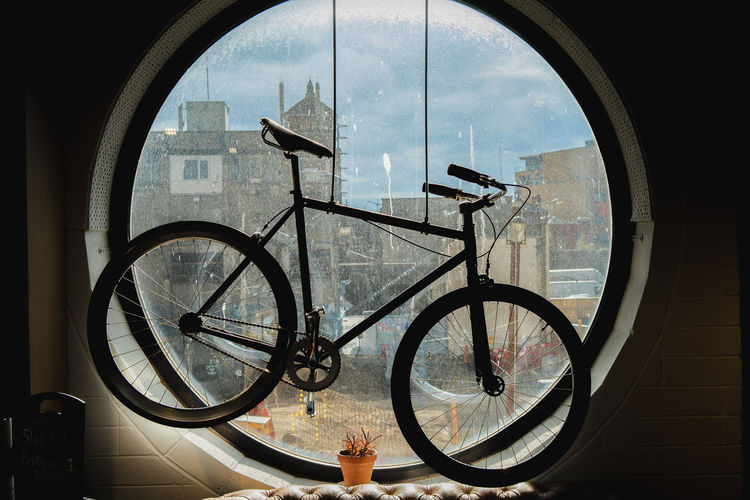 Bicycle seen through glass window