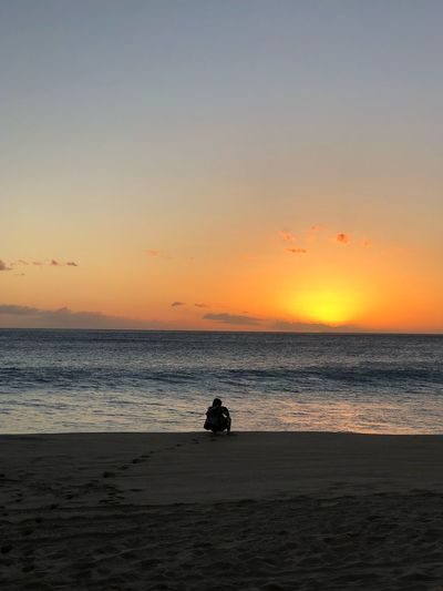 Selected For Partner Selected For Premium Oahu, Hawaii Oahu Hawaii Yokohama Waianae Sunset Sea Horizon Over Water Beach Scenics Orange Color Beauty In Nature Silhouette Nature Tranquil Scene Water Tranquility Sky Sand Real People Outdoors One Person Wave People