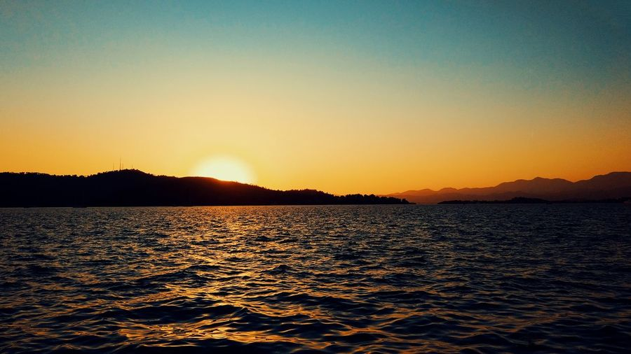 Sunset in Fethiye Xiaomiphotography Mi 5s Fethiye Mugla Sunset Sunset Water Sky Beauty In Nature Scenics - Nature Tranquility Tranquil Scene Clear Sky Orange Color Nature Waterfront No People