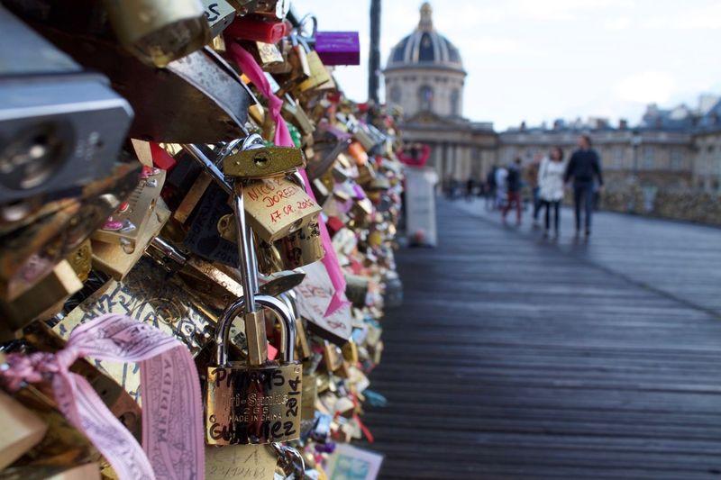 Close-Up Of Love Locks On Bridge In City