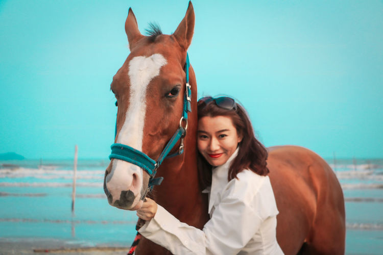 Portrait of woman with horse