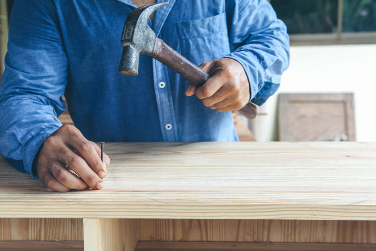 Man working on blue table